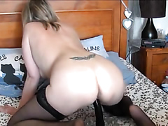Mature blonde bouncing on her big dildo