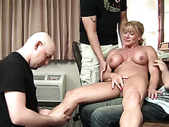 Mature female body builder and three guys