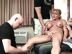 Mature female body builder and three guys