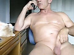 fit older married dad plays with his cock while talking on the phone