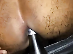 Guy using a wine bottle in his ass