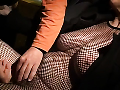 Kinky bitch in mesh gets fingered and makes a cock explode on her cunt