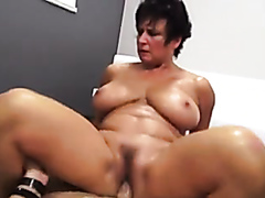 Granny sucks and rides on a large dick