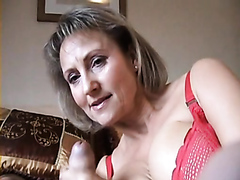 Slutty mature bimbo makes a thick cock explode in her hands