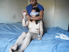Kinky tied-up slut sucks on a cock while having her pussy pleasured