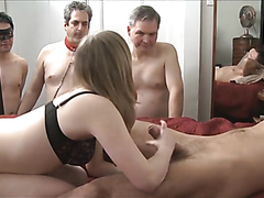 Raunchy bitch pleasures a throbbing shaft while three men watch