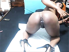 Ebony milf drills her asshole with a dildo
