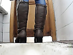 Pussy in boots pissing in the toilet