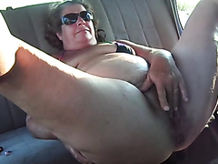 Granny rubs herself in the car