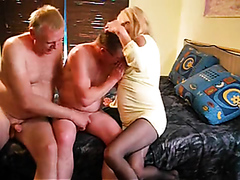 Bisexual mature threesome on the bed
