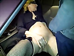 Horny milf rubs her pussy in the car