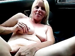 Mature wife fingers herself in the car