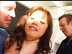 Busty Oriental minx enjoys pleasuring two throbbing cocks