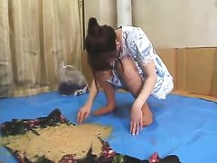 beautiful Japanese girl vomits