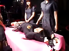 Asian mistresses play with a helpless girl