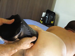 Guy slides his hand and a giant dildo in his buddy's anus
