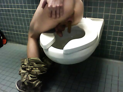 Hot young guy poops on toilet
