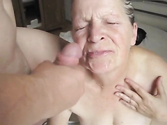 Horny grandma sucks on a cock and receives a facial