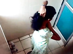 Lovely Indian girls enjoy peeing directly into the squatter