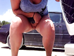 Busty chickie pees in front of her car