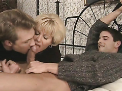 Horny boy and his lusty mom enjoy sucking on a friend's fat cock