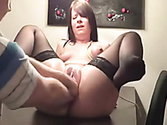 Raunchy brunette in stockings has her pussy filled with two fists