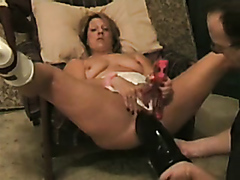 Lusty bimbo has her cunt fisted and penetrated with a monster toy