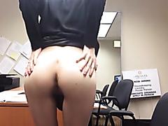 Lusty office slut enjoys fingering her orgasmic cunt
