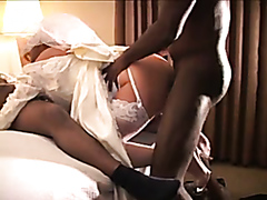 Kinky bride lets two well-hung black studs fuck her hard