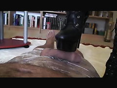 Kinky mature dominatrix delivers the perfect footjob