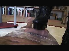 Kinky mature dominatrix delivers the perfect footjob