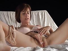 Gorgeous brunette bombshell enjoys fingering her wet twat