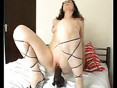Saucy brunette mommy enjoys getting drilled by a machine