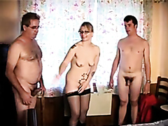 Kinky blonde slut enjoys pleasuring two throbbing shafts