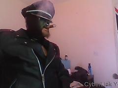 rubber hood, leather muir cap, cigar