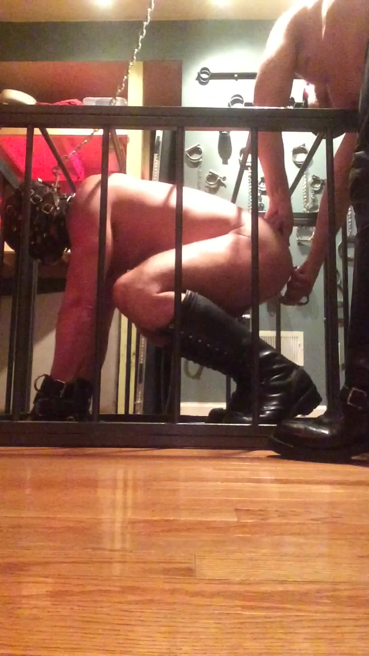 Grunt in cage with ass hook