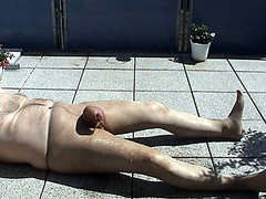Mature gay in pantyhose shows peeing outside