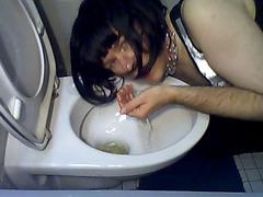 Perverted crossdresser drinks his urine from the toilet