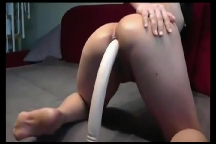 Asian babe fucke herself with a really long anal toy