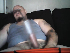 Tatt'd Muscle Bear Pumps and Masturbates Penis