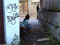 Desperate teen girl is urinating outdoors
