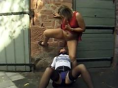 Horny lesbian women make golden shower in the street