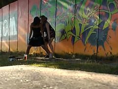 Two playgirls urinate outdoors