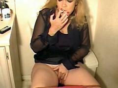 Plump blonde masturbates while piddling
