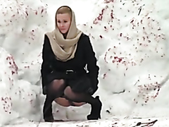 Desperate lady caught peeing outdoors