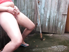 Russian girl pisses on the street