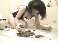 Asian babe unloads a big soft shit