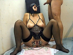 Mature woman in black mask gets hot piss flow