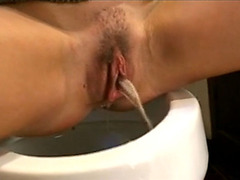 Celebrity girl Amber Wood performs sexy peeing