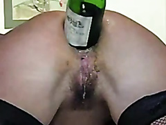 Amateur anal fisting and bottle insertion in close-up